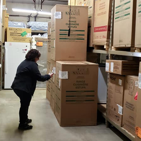 Michelle checking over the delivered products.
